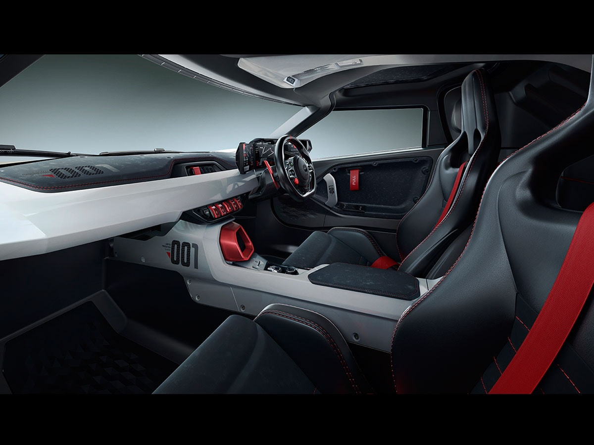 The interiors are majorly black with flashy read panels, inserts and switches along with a dual tone white and black dashboard with the lettering '001' inscribed on it. Similar numbering has been added to the side panes of the centre console to bring out the sporty essence.