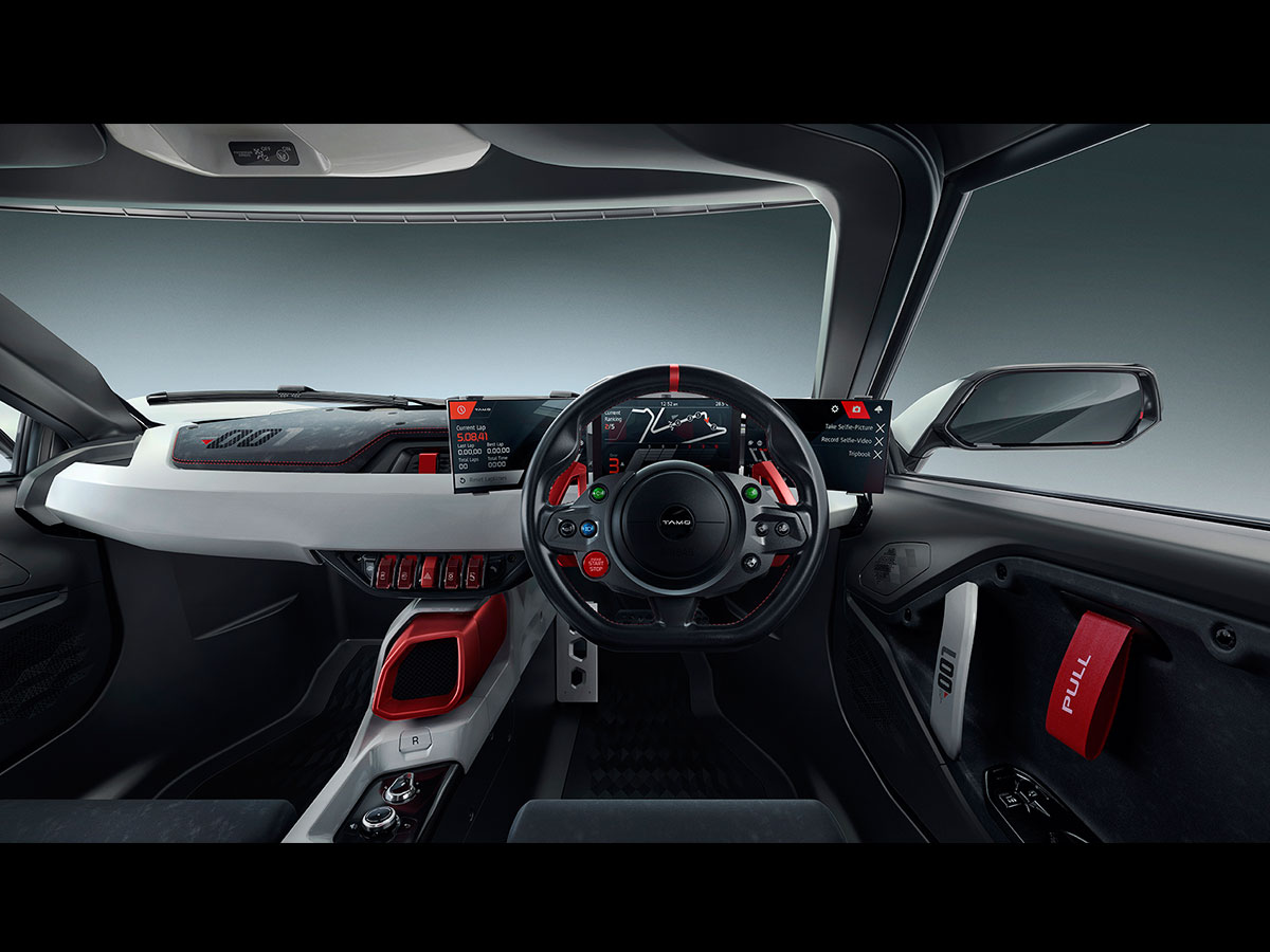 The cabin has also been designed in accordance with the Racemo's sports car character. So, you get the large display behind the steering wheels, a clean and uncluttered dashboard, flat-bottom steering wheel with controls.
