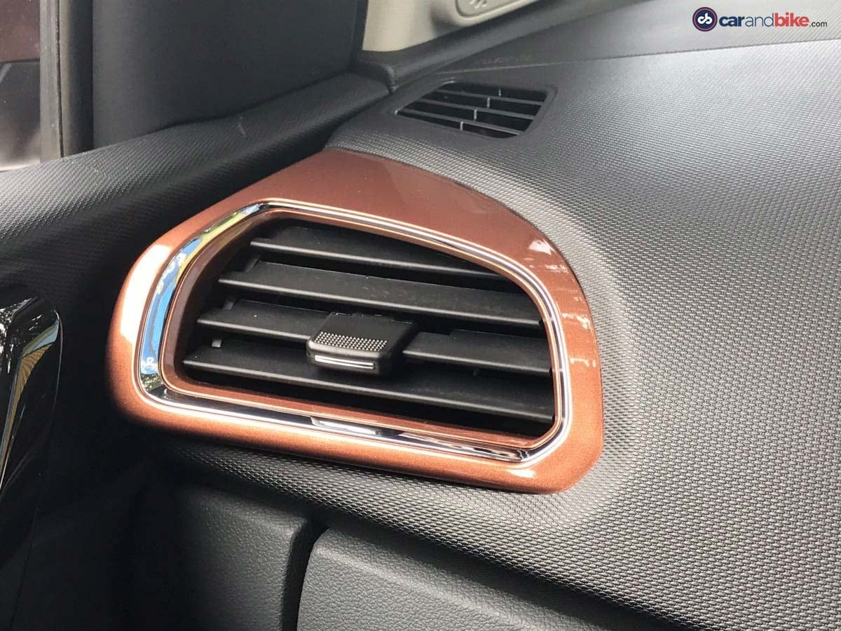 The colour on the AC vents surrounds match the body colour of the Tigor