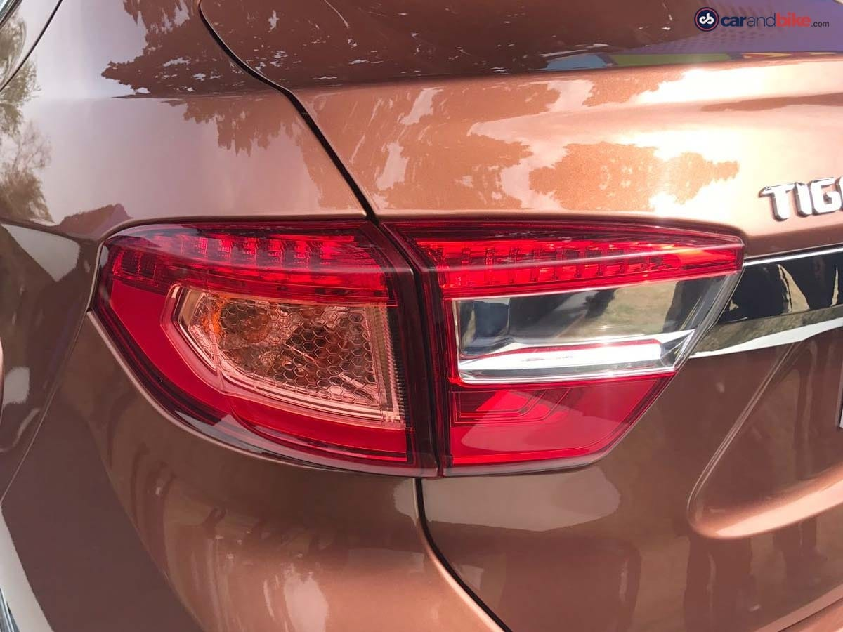The rear sees wraparound tail lamps along with a well-designed rear bumper