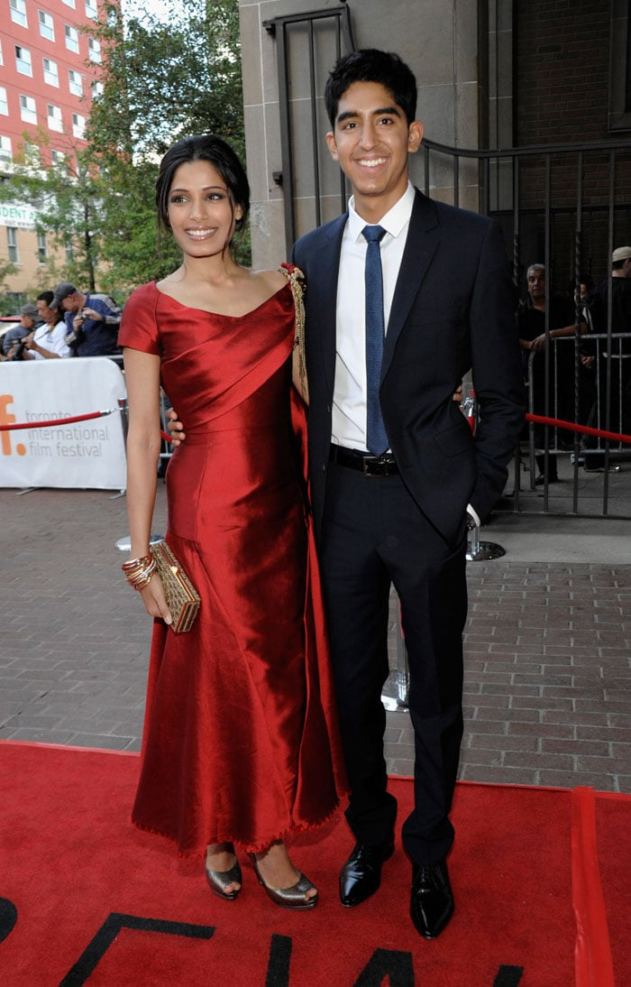 Freida, Dev walk the red carpet at Toronto Fest