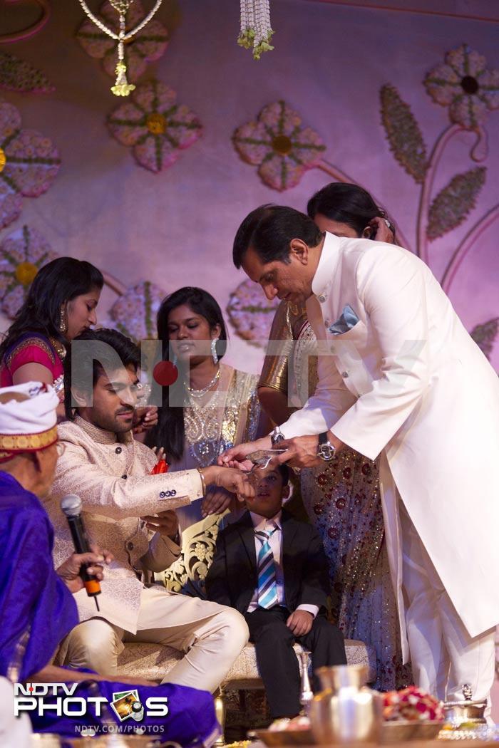ram charan teja and upasana perform special pooja ahead of
