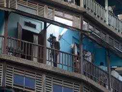 Photo : On the Other Side of Fame: SRK Films Fan in Mumbai Chawl