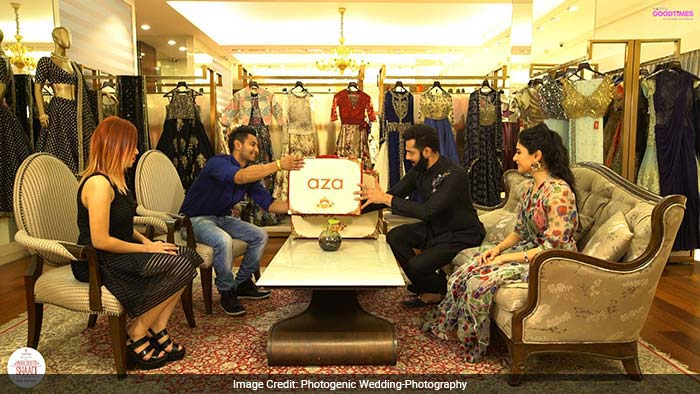 Devangi Parekh, Creative Director of Aza Fashions along with anchor Rudy, helping Angshuman and Viddya choose their outfits for the cocktail night.