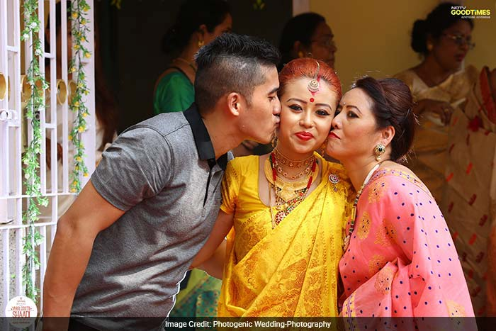 Viddya with her mother and brother showering all their love on her.