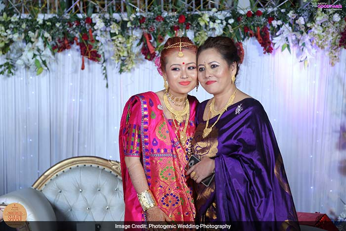 Viddya with her mother. In Assamese weddings, a bride's reception starts first and the groom's clan joins in later.
