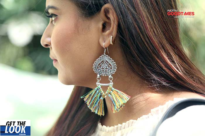 These bold earrings give Malaya's look that extra edge