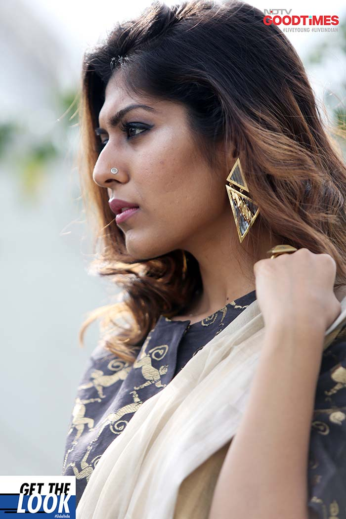 These geometric statement earrings are perfectly complementing Diksha's chic outfit