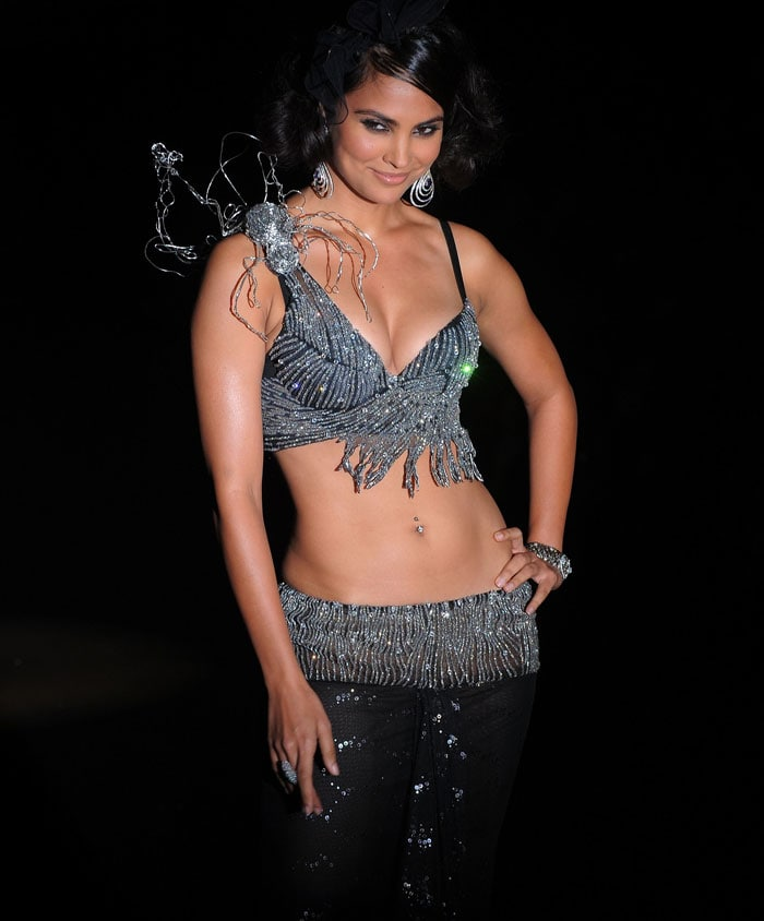 Lara Dutta walks the ramp for Rina Dhaka