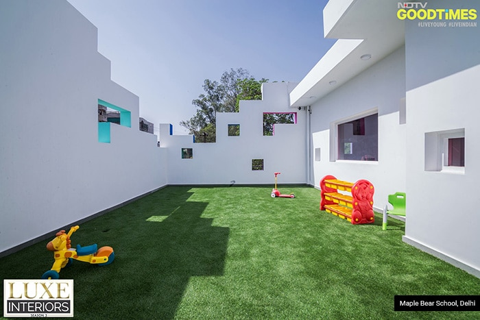 Every classroom has a playing lawn attached to it. With greenery, sunshine on faces, and toys all over the place, this one surely is every child's happy spot.