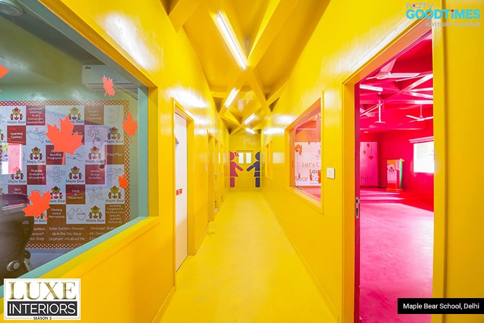 How do you amplify a narrow corridor in school? By painting it yellow! How do you make it quirky? By building a zigzag ceiling.
