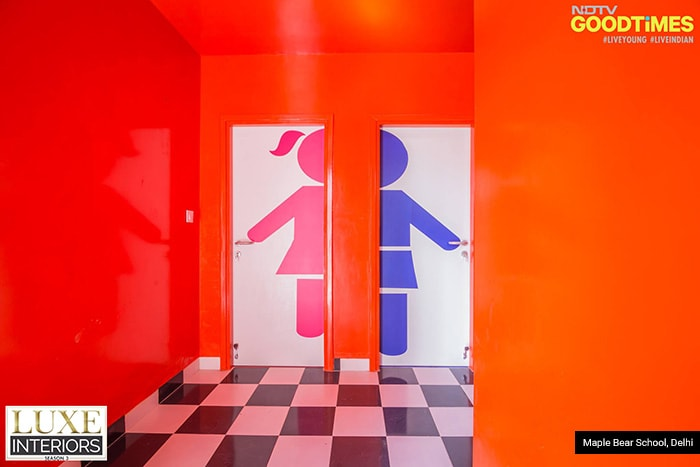 The pathway leading to the washroom has innovation written all over it. With solid red walls, and a checkerboard tiling, it leads to the washroom doors with peculiar 'girl/boy' logos in half, to attract the toddlers.
