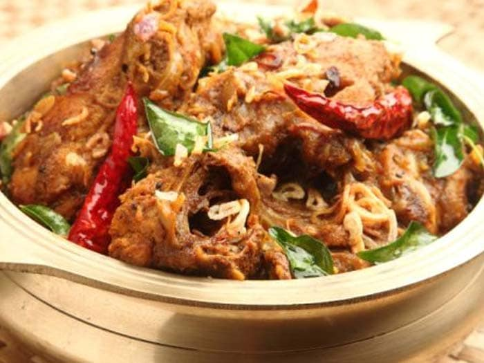 Kolhapuri Chicken: Trust us you want to have water handy at all times before jumping in to eat this! Spicy is an understatement, your tongue will feel seared with unapologetic spiciness!