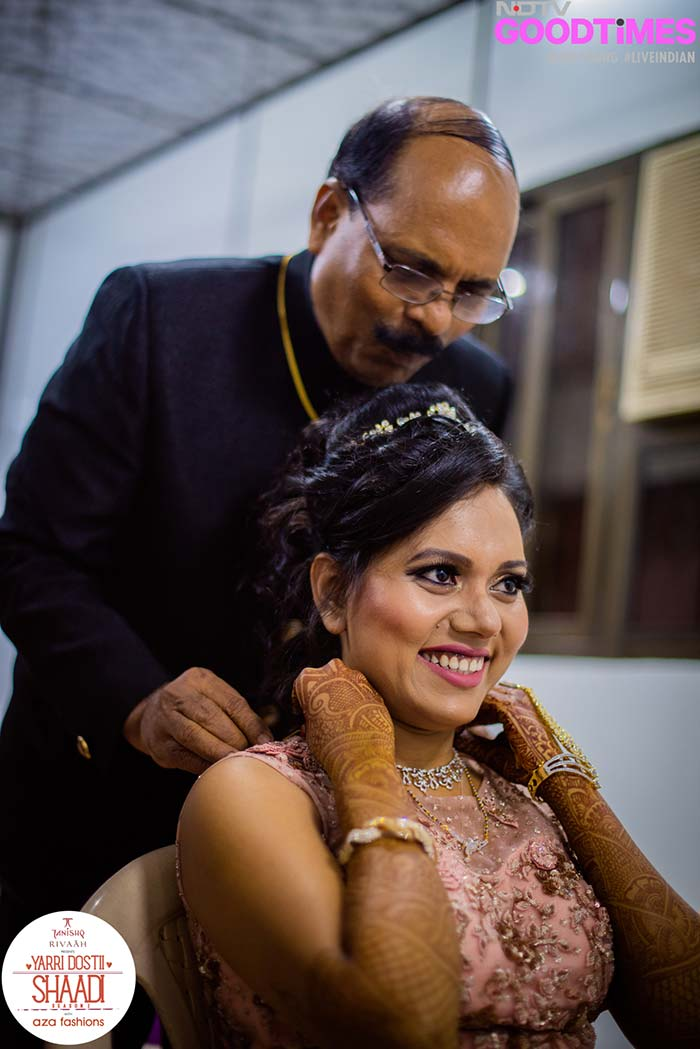 Supriya and her father share a precious moment as he gets her ready.