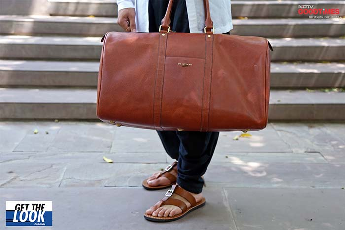 Yuvraj flaunting his Da Milano bag
