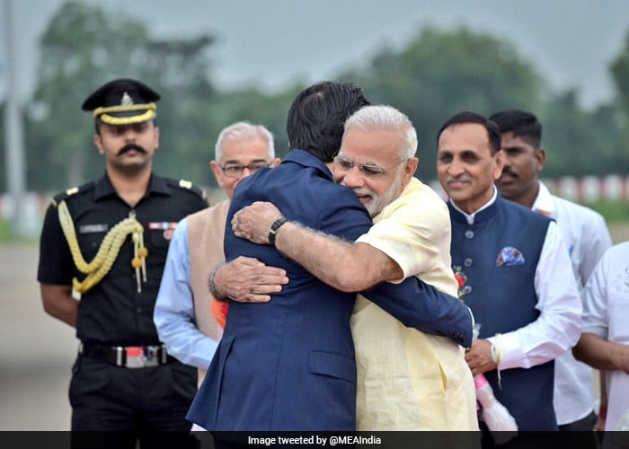 Japan PM Shinzo Abe Receives Warm Welcome From PM Modi: Pics