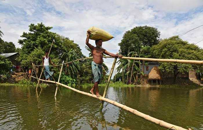 Villagers have been using makeshift bridges to cross flooded areas. (Reuters)