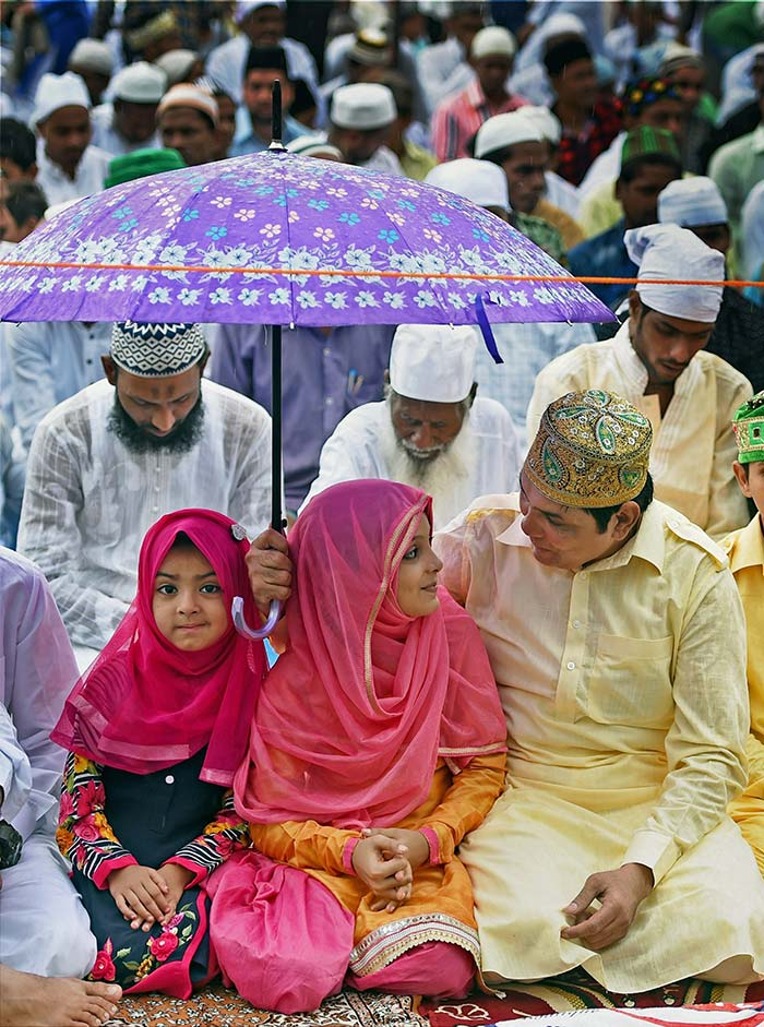 Children join Eid celebration and prayers with their families, amid rains in Mumbai.