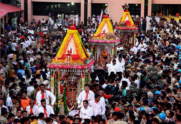 Devotees take part in a procession during the 140th rath yatra in Ahmedabad.