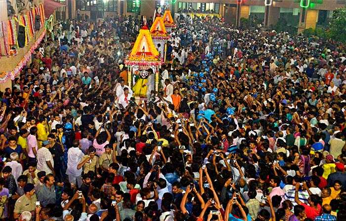 Devotees took pictures of the rath yatra during a procession in Ahmedabad.