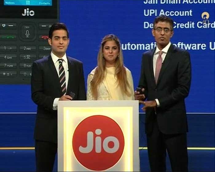 Akash Ambani and Isha Ambani demonstrate features of JioPhone