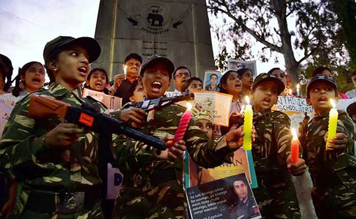 Children dressed in Army uniforms light candles to remember Kargil war heroes.