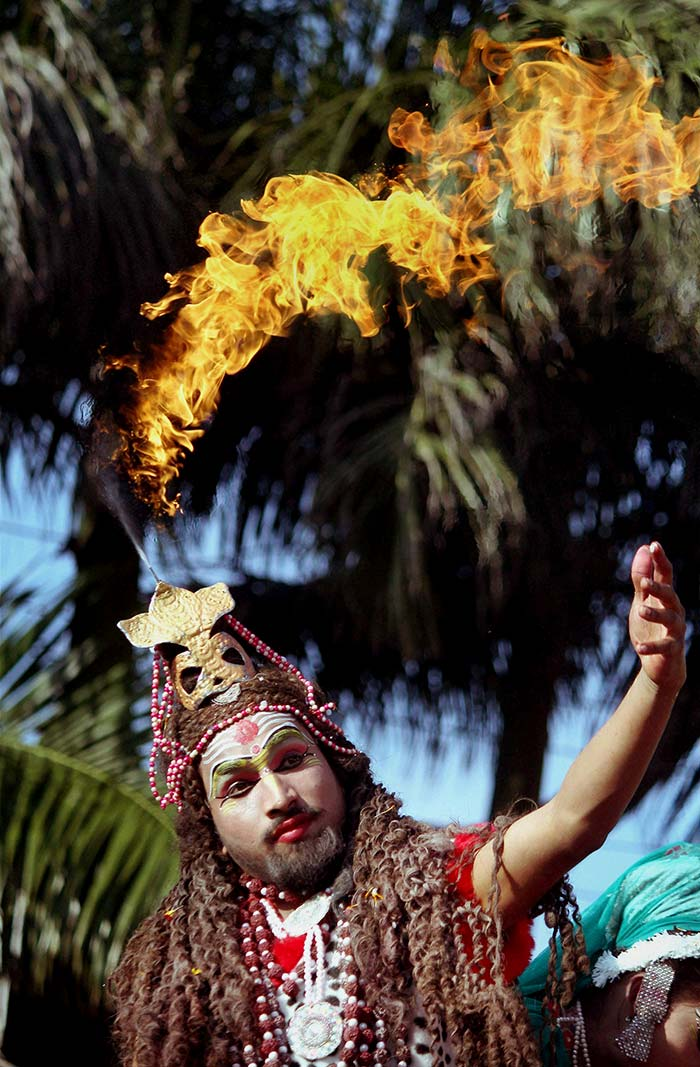 A devotee dressed up as Lord Shiva participates in a religious procession on eve of Maha Shivratri. (PTI Photo)