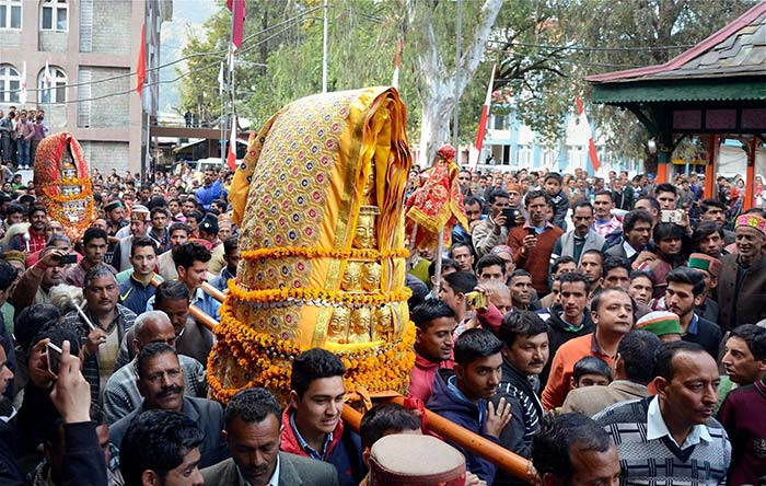 Devotees carry palanquins of Deities during a procession as part of the Maha shivratri festival in Mandi. (PTI Photo)