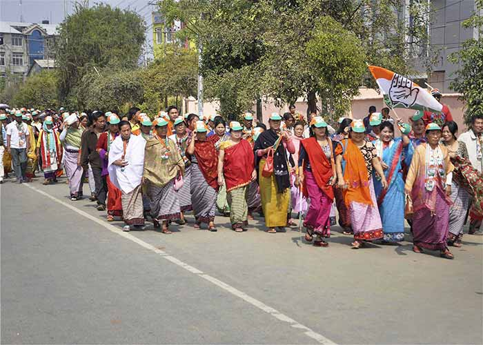Congress supporters during an election campaign for Assembly polls at Hapta Kangjeibung in Imphal East on Tuesday.
