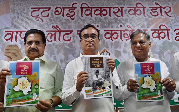 Delhi Congress president Ajay Maken launches manifesto for MCD elections in New Delhi on Monday.