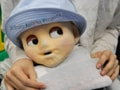 Photo : Japanese scientists unveil baby robot