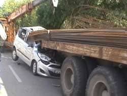Photo : Iron rods sticking out of truck pierce through car in Noida, driver killed