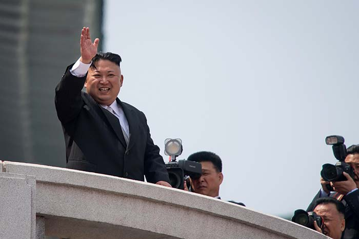 North Korean leader Kim Jong-Un waves from a balcony of the Grand People's Study house following a military parade marking the 105th anniversary of the birth of late North Korean leader Kim Il-Sung, in Pyongyang on April 15, 2017. (AFP)
