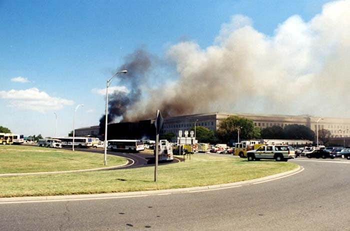 The photo shows smoke billowing from the Pentagon after the crash of American Airlines Flight 77 on September 11, 2001.