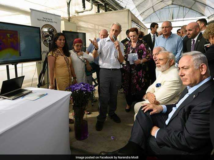 PM Modi watches a demonstration on the latest innovations in agriculture.