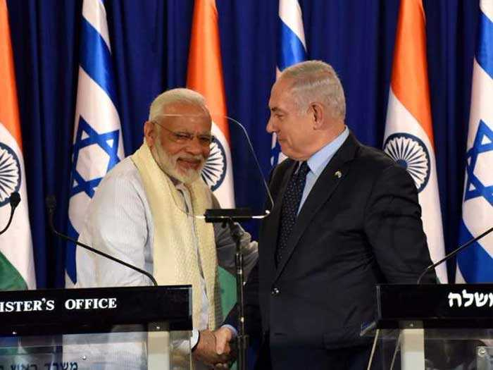 PM Modi and his Israeli counterpart share a laugh at a meeting with the press.