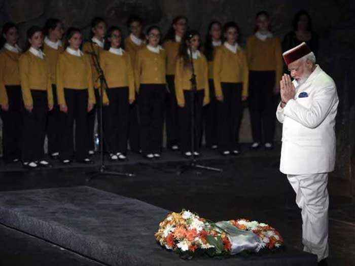 PM Modi attends a wreath laying ceremony at the Yad Vashem holocaust memorial.
