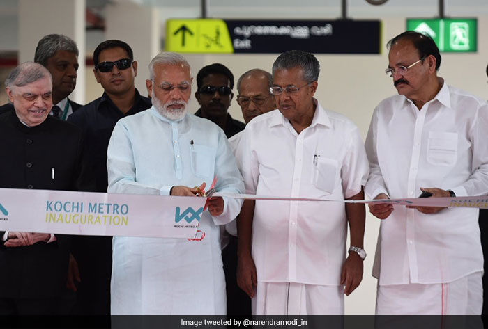 PM Modi cuts the ribbon to inaugurate the Kochi Metro, which will reduce the usual travel time of 45 minutes from Aluva to Palarivattom by road to just 23 minutes.