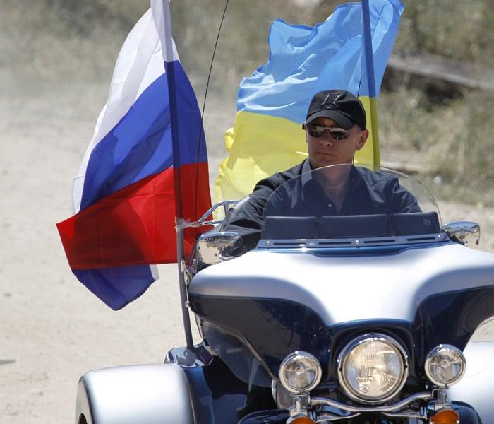 Putin rides Harley Davidson at motorcycle show