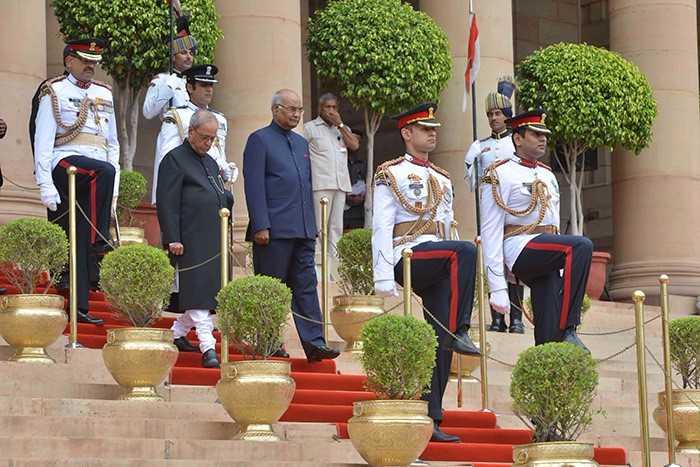 President Ram Nath Kovind walks down the stairs of the Rashtrapati Bhavan with former president Pranab Mukherjee at his swearing in ceremony