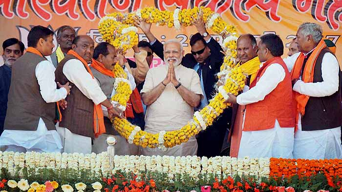 Prime Minister Narendra Modi being garlanded at a rally in Mau, Uttar Pradesh.