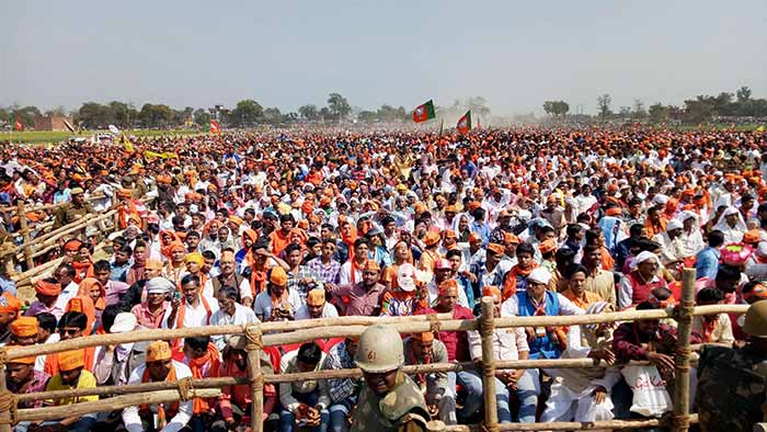 Crowd cheers as PM Modi gives his speech at a rally in Mau, Uttar Pradesh.