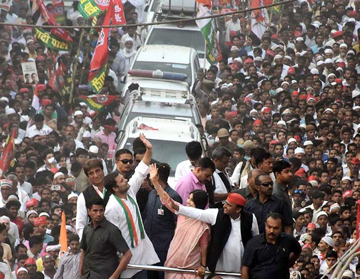 Congress Vice President Rahul Gandhi, UP Chief Minister Akhilesh Yadav with wife Dimple Yadav and other leaders during their road show in Varanasi on Saturday. (PTI Photo)