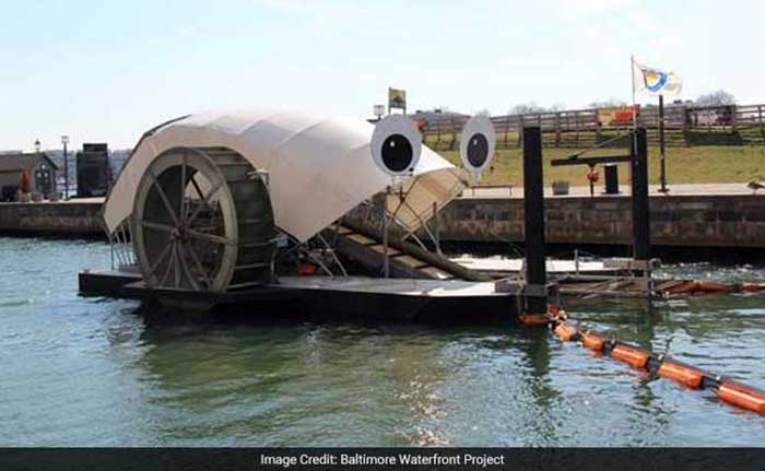 United States Of America: Robot's Act of Collecting Waste: Powered by sun and strong river current, the eco-friendly robotic machine picks up garbage and debris from the Baltimore River and deposits the waste into a dumpster barge which is built into this machine. Within a period of 3 years, Mr. Trash Wheel has successfully removed 1.1 million pounds of garbage.