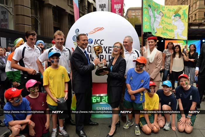 Australia's Prime Minister Tony Abbott (centre L) and Gabrielle Upton, sport and recreation minister also appear every bit as excited about the World Cup.