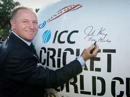 New Zealand PM John Key signs a giant cricket ball to show his eager support to the event.