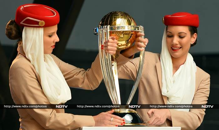 Air hostesses place the ICC Cricket World Cup 2015 trophy on a podium as part of celebrations in Sydney.