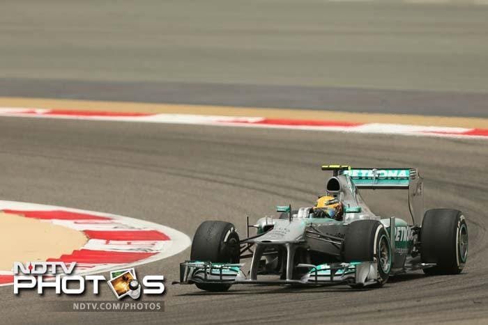 Mercedes racer Lewis Hamilton was fourth but will start ninth following a five-grid penalty for a gear box change.
