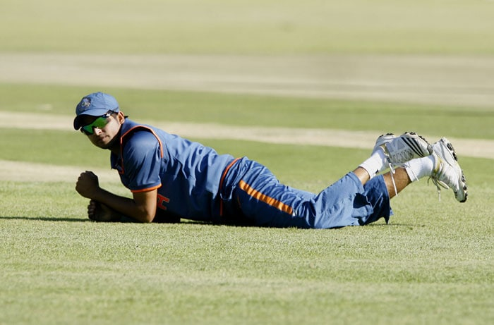 Indian captain on the ground after missing a ball to give away four runs to Zimbabwe. (AFP PHOTO)