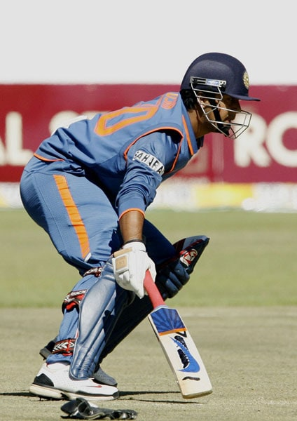 Indian batsman Pragyan Ojha completes a run against Zimbabwe at the Harare Sports Club during the fourth ODI of the tri-series. (AFP Photo)